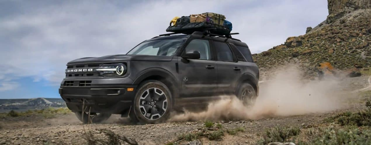 A black 2021 Ford Bronco Sport is off-roading in the desert.