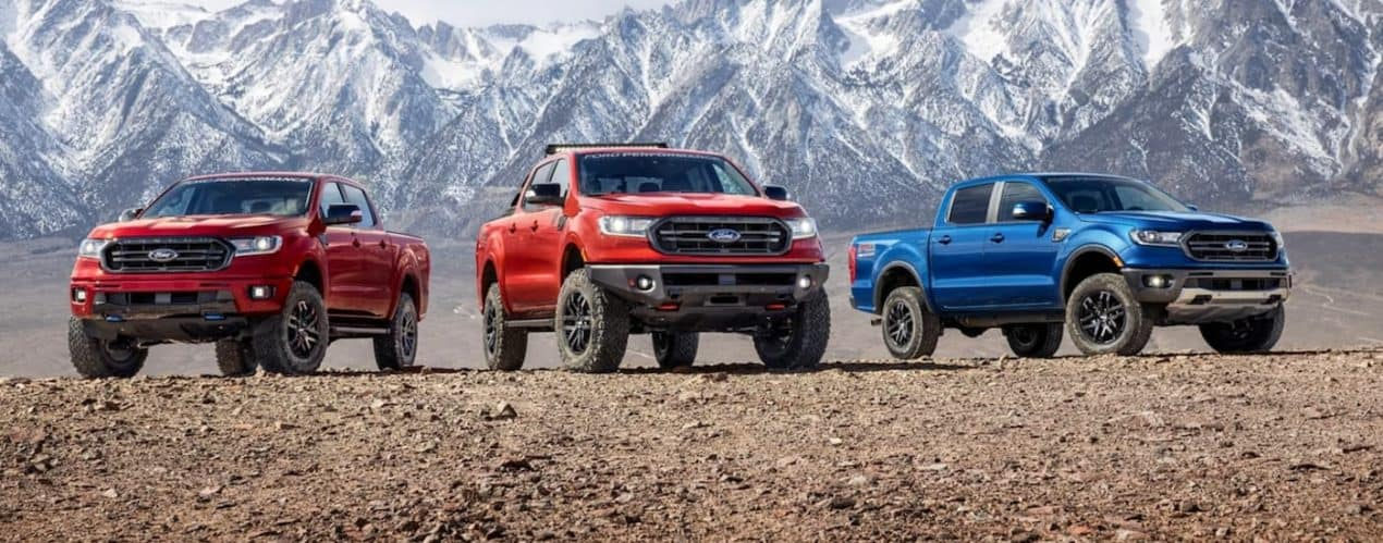 Three of the 2021 Ford Ranger Performance trims are parked in front of snowy mountains.