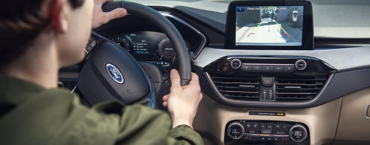 The rear camera view is shown on the screen in a 2021 Ford Escape.