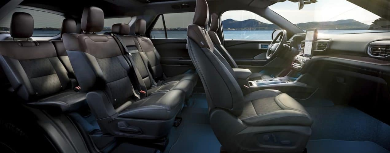 The black interior of a 2021 Ford Explorer is shown from the side.
