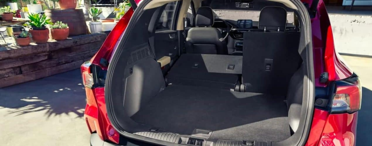 A close up shows the cargo area in a red 2021 Ford Escape Hybrid.