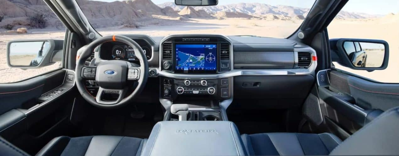 The dashboard and screen are shown in a 2021 Ford F-150 Raptor.