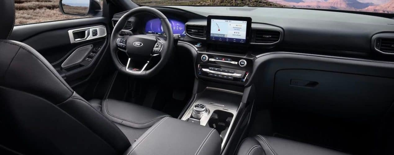 The black dashboard and infotainment screen are shown in a 2021 Ford Explorer.