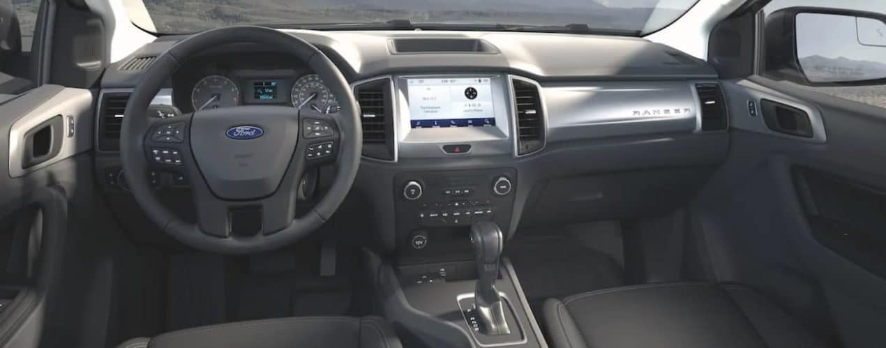 A close up shows the black interior and infotainment system in a 2021 Ford Ranger STX.