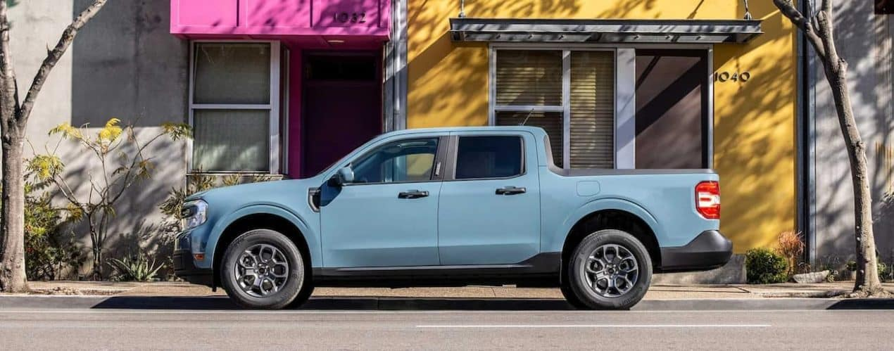 A blue 2022 Ford Maverick is shown parked on a city street.